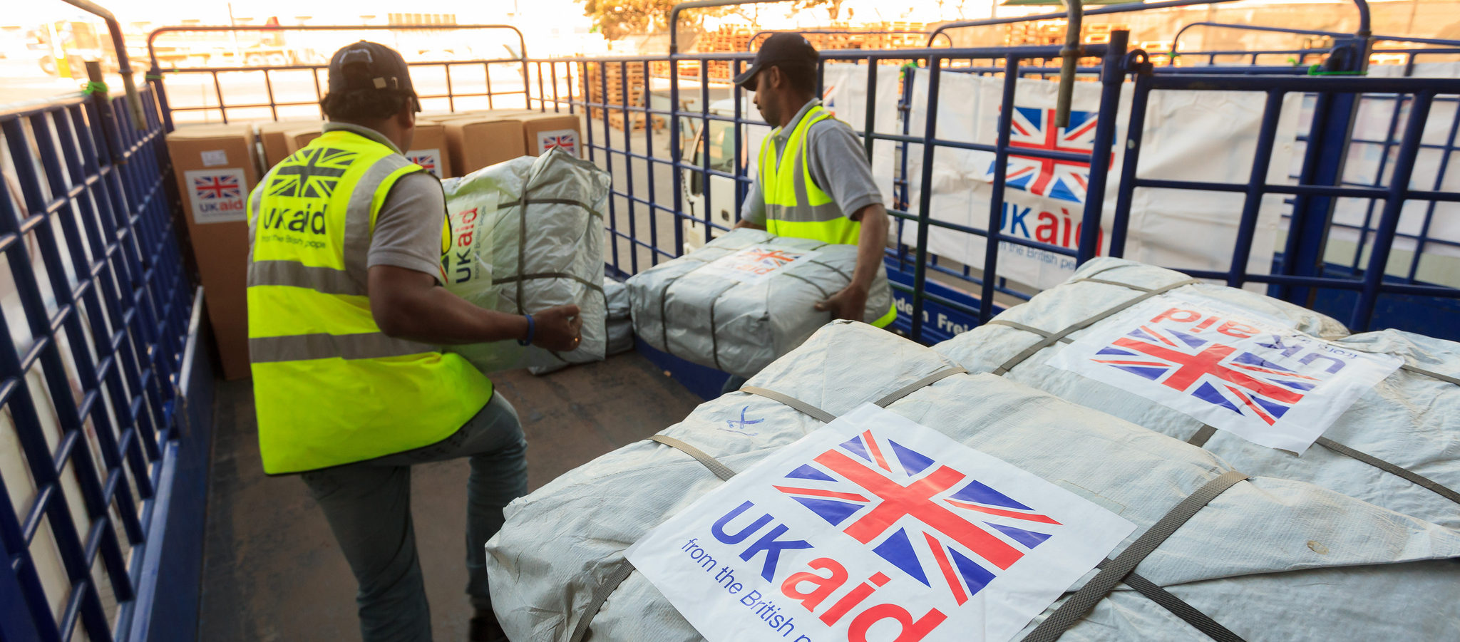 UK research's impact on international development. Photo cred - DFID, UK aid shelter kits are loaded for shipment in Dubai